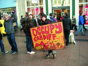 protester holding an Occupy Cardiff sign